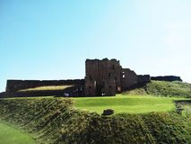 Tynemouth castle England. Castle behind green yard on sunny day at Tynemouth Englandn Royalty Free Stock Photos