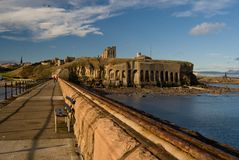 Tynemouth castle and priory. Focused from the spit, autumn, east coast , sunny weather with polarised cloudy sky, north sea, Newcastle, England, United Kingdom Royalty Free Stock Image