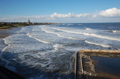 Tynemouth longsands and old pool. High tide at Longsands beach Tynemouth Stock Photos