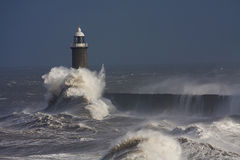 Tynemouth Pier. And rough winter stormy weather with breaking waves Royalty Free Stock Photo
