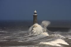 Tynemouth Pier. And rough winter stormy weather with breaking waves Stock Image