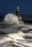 Tynemouth Pier. And rough winter stormy weather with breaking waves Stock Images
