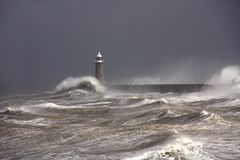 Tynemouth Pier. And rough winter stormy weather with breaking waves Stock Photos