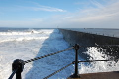 Tynemouth pier and crashing waves Royalty Free Stock Photo