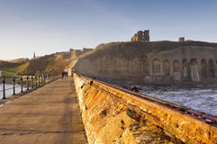 Tynemouth priory and castle from north pier royalty free stock images