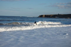 Tynemouth surf. Surfing at tynemouth longsands beach Royalty Free Stock Images