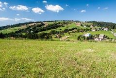 Tyniok hill near Koniakow village in Beskid Slaski mountains in Poland Royalty Free Stock Photography