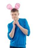 Type adulte avec des oreilles de lapin Images stock