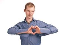 Type adulte dans un isolat bleu de chemise rayée Images stock