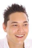 Type asiatique heureux Image libre de droits