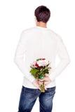 Type avec le bouquet des fleurs Photographie stock libre de droits