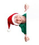 Type avec le chapeau et le signe de Santa Photo stock