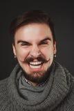 Type beau avec la barbe dans le pull de laine Image stock