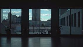 Type a dark corridor of high windows, which go passersby. Type a dark hallway in an office room with high windows, which run passers summer stock footage