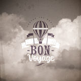 Type design with Vintage hot air balloon. Vintage hot air balloon and type design against a clouds background Royalty Free Stock Images