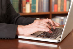 Type a document. Close-up of male fingers typing a business document on the grey laptop Royalty Free Stock Photography