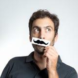 Type drôle avec la fausse moustache Images libres de droits