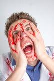 Type drôle fou couvert dans le sang Photos libres de droits