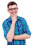 Type gai en verres avec la main près du menton Images libres de droits