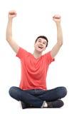 Type heureux avec des bras augmentés Photos libres de droits