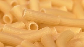 Type of Italian pasta, background, rotation, close. One type of Italian raw, fresh pasta maccheroni, background, rotation, close up stock video