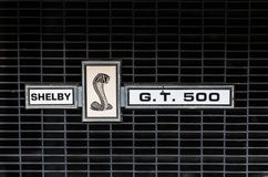 Type plate on the front grille of a vintage Mustang. stock photo
