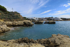 Type of relief (Albufeira, Portugal). Stone ledges in water (Albufeira, Portugal Royalty Free Stock Photography