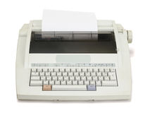 Type up!. White electronic typewriter with paper sheet on a white background. The front view royalty free stock images