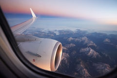 Type in the window of the plane of the Alps Royalty Free Stock Photo