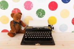 Type writer and vintage bear Stock Photos
