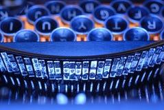 Typebar en sleutels in sinaasappel Stock Foto