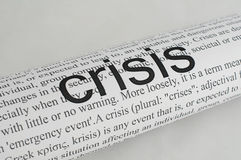 Typed text Crisis on paper. Typed text Crisis on white paper Royalty Free Stock Photos