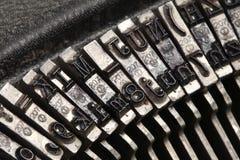 Typeface of old typwriter. Close-up of typeface of old travel typewriter Royalty Free Stock Image