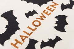Typeface text for halloween logo handwritten on white background,. Decorated orange typeface text for halloween logo with traditional symbols handwritten on Royalty Free Stock Photography