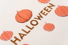 Typeface text for halloween logo handwritten on white background,. Decorated orange typeface text for halloween logo with traditional symbols handwritten on Royalty Free Stock Images