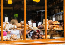 Types of bread in bakery shop window. Royalty Free Stock Images