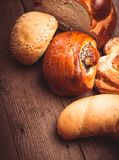 Types of bread. Types of homemade bread on the rustic wooden table royalty free stock photo