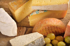 Types of cheese with grapes Royalty Free Stock Photos