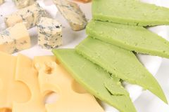 Types of cheese on wooden platter. Stock Photo