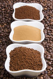 Types of coffee. Grounds, instant and powder on coffee beans background Stock Photos