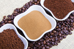 Types of coffee. Grounds, instant and powder on coffee beans background Royalty Free Stock Photos