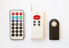 3 types d'à télécommande avec le divers nombre des boutons Images stock