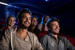 Types heureux au cinéma Photographie stock libre de droits