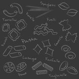 Types of pasta food outline symbols on black board Royalty Free Stock Images