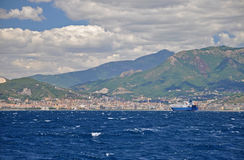 The types of the Peninsula of Sorrento from the sea and big blue. The Italian Peninsula of Sorrento from the sea and big blue ship - with mountains, blue sky Stock Image