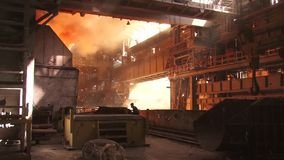 Types of plant shop. View of the metallurgical plant fire liquid metal stock footage