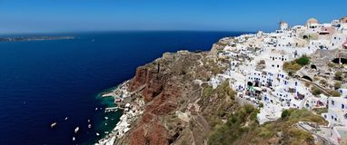 Types of Santorini. On top of a high mountain of Santorini, see the white town. Its walls, terraces down the hillside. At the foot of the island is the harbor Stock Images