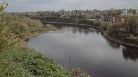 Types of small town. Views of a small city. bridge. hotel. People are walking in the park. Types of small river. The center of a small town. the city`s stock video