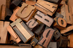 Typescript letters in a box. Cardboard box with lots of wooden typescript letters Royalty Free Stock Images