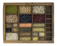 Typesetter case with assorted beans, grains, seeds Stock Photos
